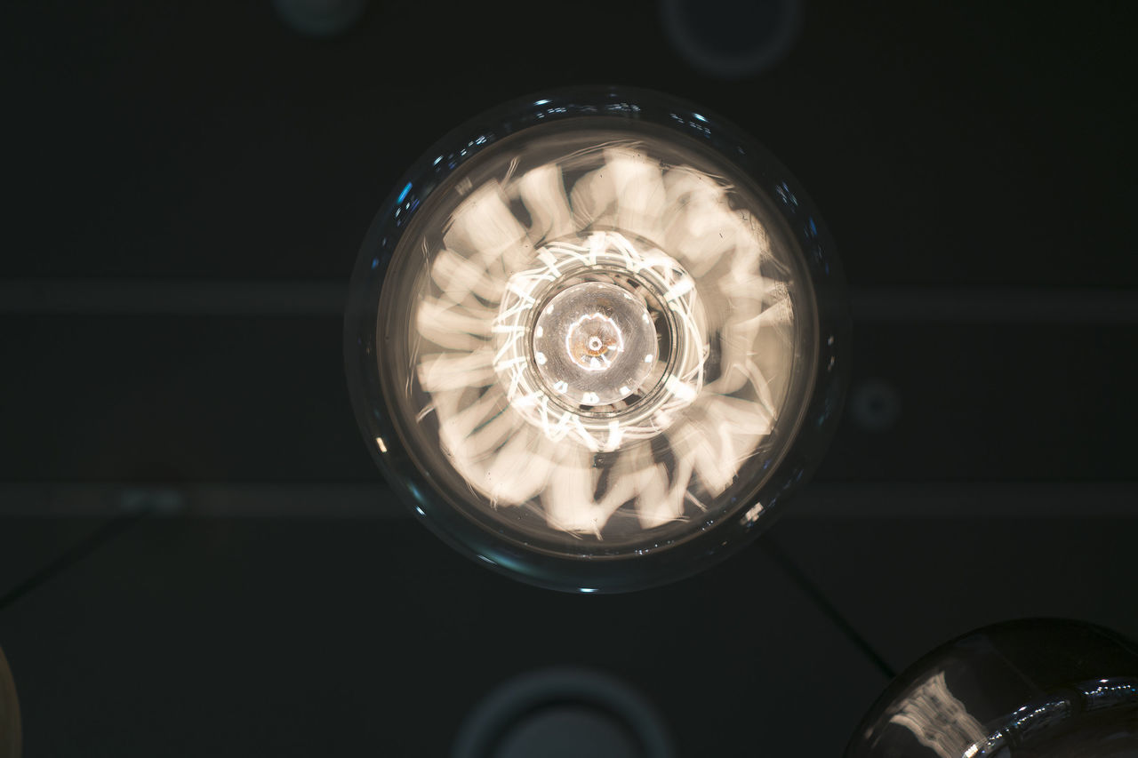 Close-up of electric light hanging from ceiling