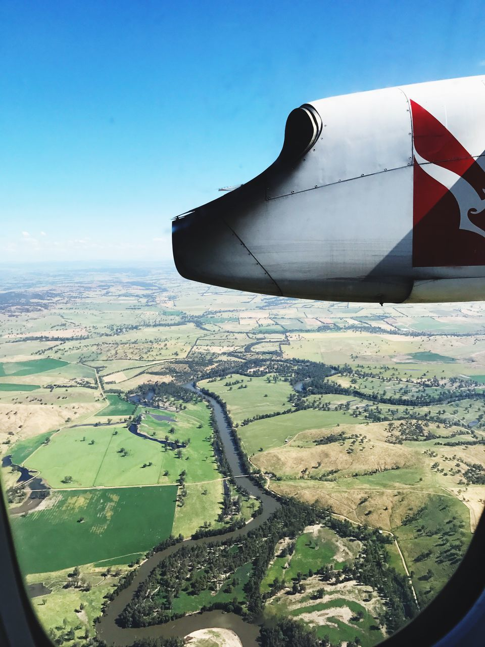 transportation, airplane, landscape, aerial view, air vehicle, flying, mode of transport, day, journey, travel, mid-air, outdoors, no people, nature, sky, clear sky, scenics, patchwork landscape, beauty in nature, airplane wing