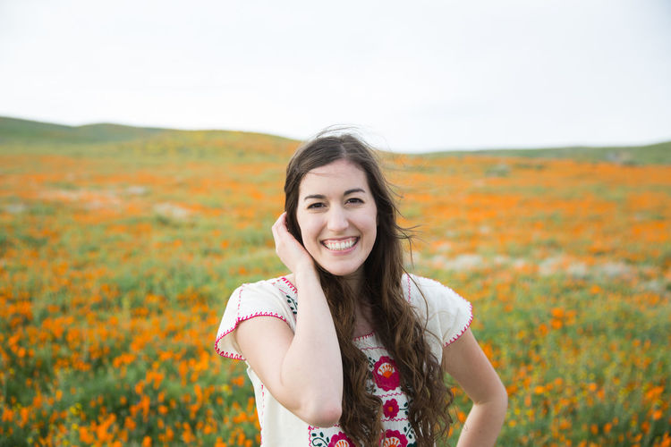 Cheerful Field Field Of Flowers Flower Happiness Looking At Camera Nature One Person Outdoors Poppy Fields Portrait Smiling Spring Springtime Wildflowers In Bloom
