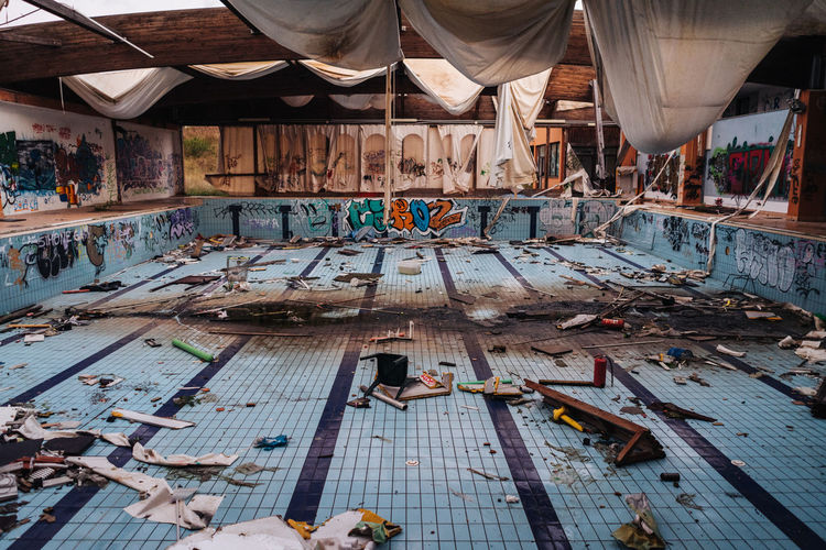 View of dirty abandoned swimming pool