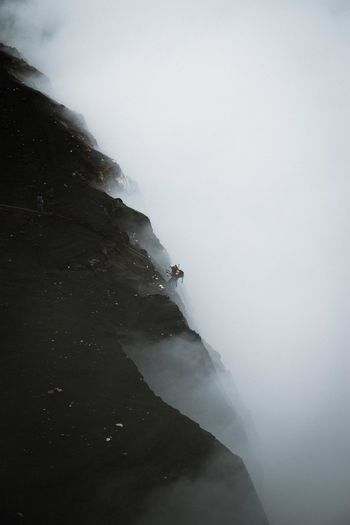 Beauty In Nature Cliff Climbing Cold Temperature Day Fog Landscape Mist Mountain Nature One Person Outdoors People Physical Geography Power In Nature Scenics Sky Volcanic Landscape Volcano Water Waterfall Winter