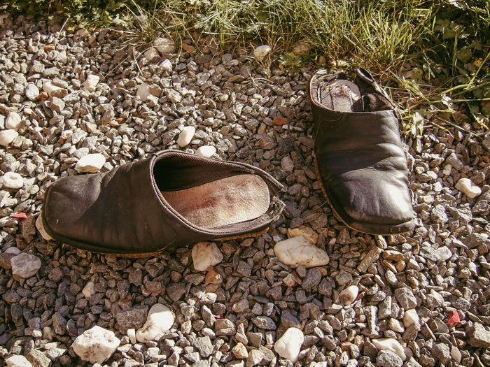 High angle view of shoes on pebbles