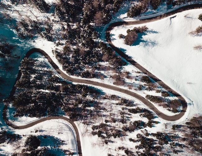 Aerial view of winding road during winter