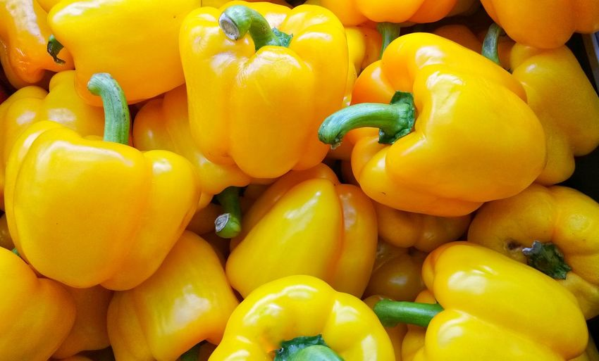 Fresh chlli banggala disply at market place Full Frame Business Finance And Industry Bell Pepper Ripe Juicy Paprika Yellow Bell Pepper Stall Market Stall For Sale Pepper - Vegetable Farmer's Market Farmer Market Persimmon