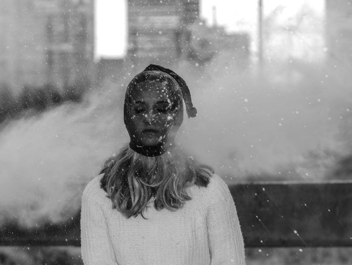 Woman in city during snowing