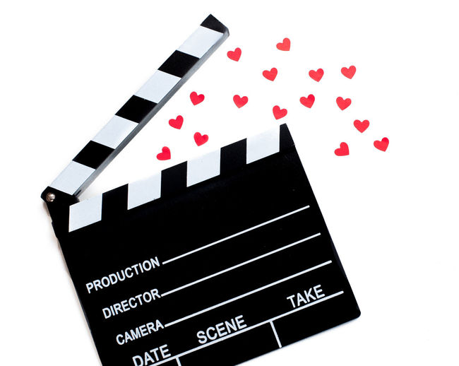 Movie clapper and little red hearts Black Color Clapper Clapperboard Close-up Day Hearts Indoors  Love Love Movies Love ♥ Many MOVIE No People Red Romantic Movie Studio Shot Symbol Valentine's Day  White Background