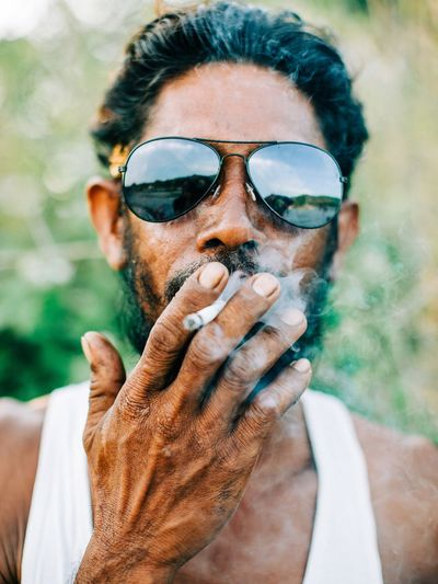 Smokey! Headshot Portrait Real People One Person Lifestyles Glasses Adult Sunglasses Human Body Part Close-up Hands Covering Mouth
