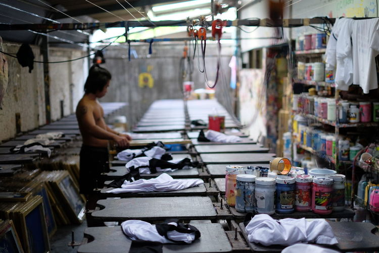 Business Finance And Industry People Working Indoors  Occupation Real People Industry Men Manual Worker Day Only Men One Person UNPOSED Bangkok Thailand Shirt Screen Screenprinting Shirt Design Tshirt Tshirt Designer Tshirtdesign Tshirtart Tshirtsdesign Tshirtprint