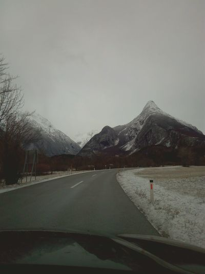 Mountain One Person Road Adults Only Sky Scenics Adult Outdoors Landscape Nature Travel Destinations Day People Mountain Range Snow Cold Temperature Beauty In Nature