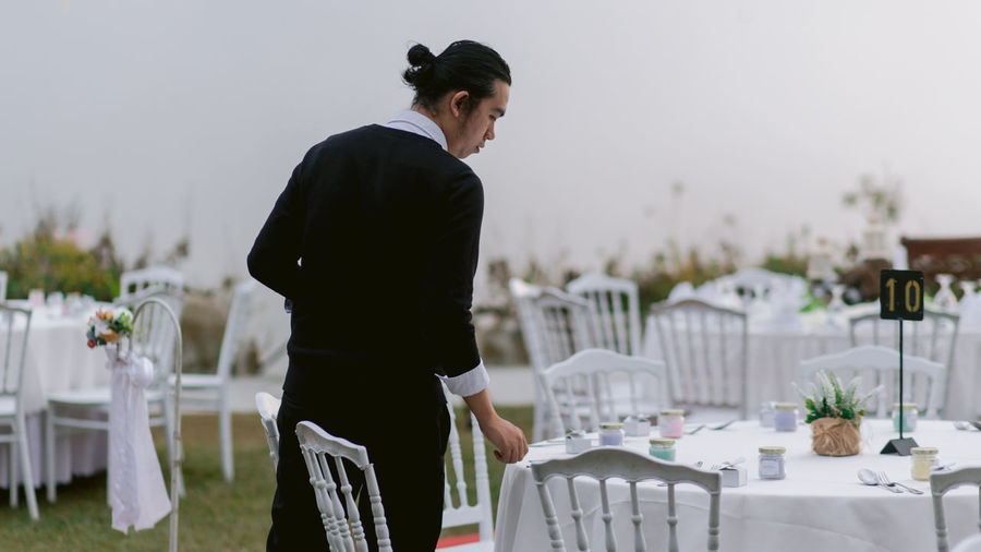 Man looking at table outdoors