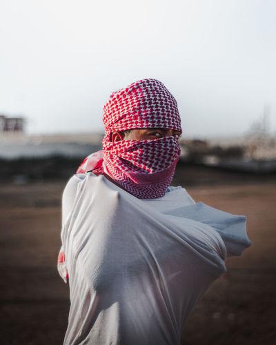 Man wearing hat standing on field