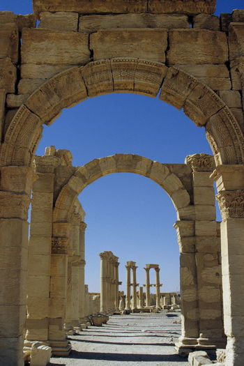 Palmyra before the civil war. Ancient Civilization Antiquity Arch Architectural Column Architecture Building Exterior Built Structure Clear Sky Day History Low Angle View No People Old Ruin Outdoors Palmyra Palmyra Ruins Roman Antiquity Ruins Sky Stone Syria  Tadmor