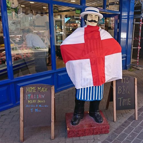 Outside a butchers during world cup Butcher Shop Lincoln Patriotism St George Flag Of England Human Representation Shopping Standing world cup 2018