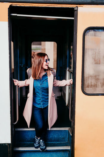 Full length of woman standing by train
