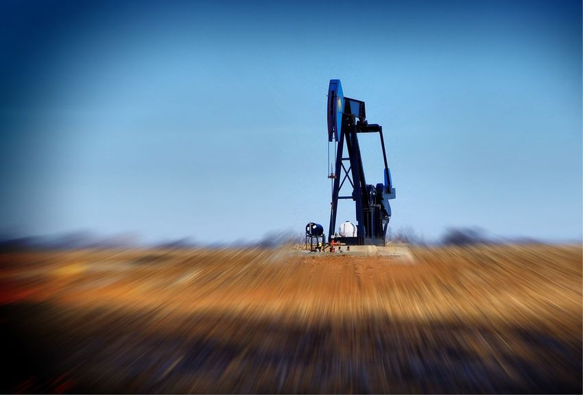 Oil well jack pump extracting petroleum in focus with foreground and background blurred Extraction Exploration Well  Gas Gasoline Fuel Fossil Co2 Carbondioxide Change Climate Earth Change Climate Company Industrial Industry Field Motion Blurred Motion No People Industry Day Outdoors Rural Scene Drilling Rig Technology Nature Oil Pump Fuel And Power Generation