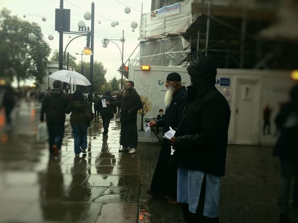 Spreading Islam Oxford Street, London Leaflet Adult City Crowd Day Handing Out  Islam London Marble Arch Men Muslim Outdoors Oxford Street  People Rain Real People Recruiting Religion Religious  Spreading Street The Photojournalist - 2017 EyeEm Awards Waiting Walking Wet