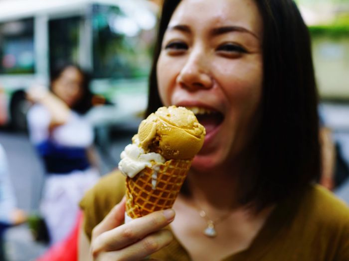 Portrait of woman having ice cream cone
