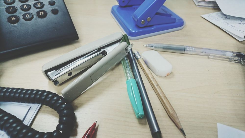 Busy life, work hard Indoors  Table Business Finance And Industry Busy Day Working Hard Work Life Stress Chaos Messy Life Table Setting Pen Pencil Eraser Staples Phone Business