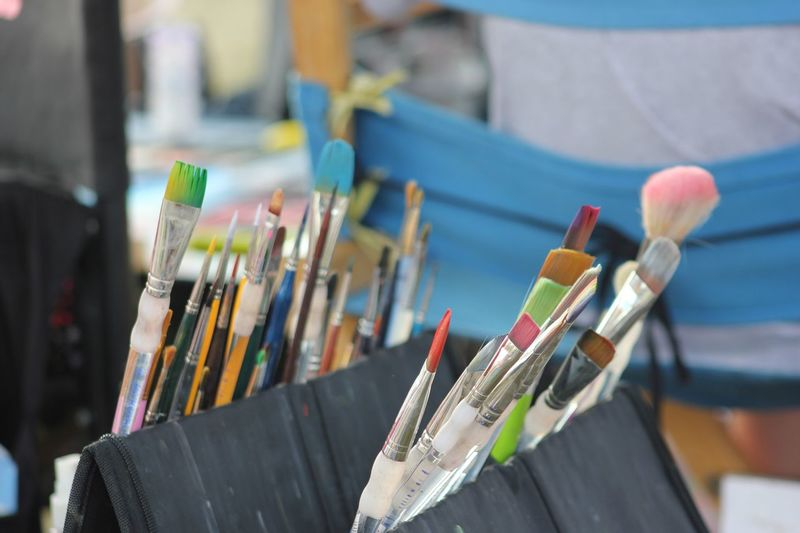 Close-up of multi colored paintbrushes