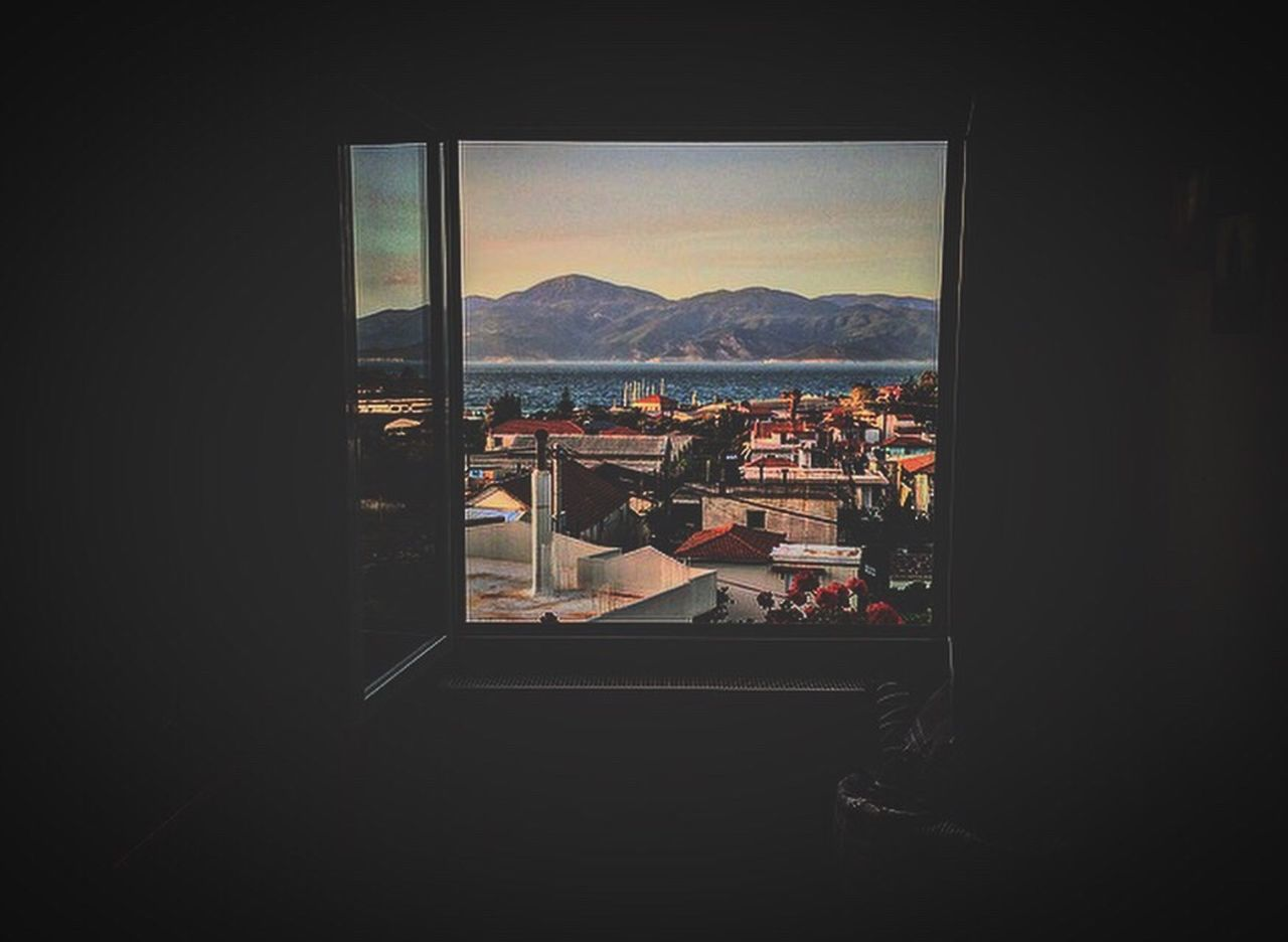 window, mountain, indoors, built structure, architecture, cityscape, day, nature, building exterior, no people, city, water, sky, beauty in nature