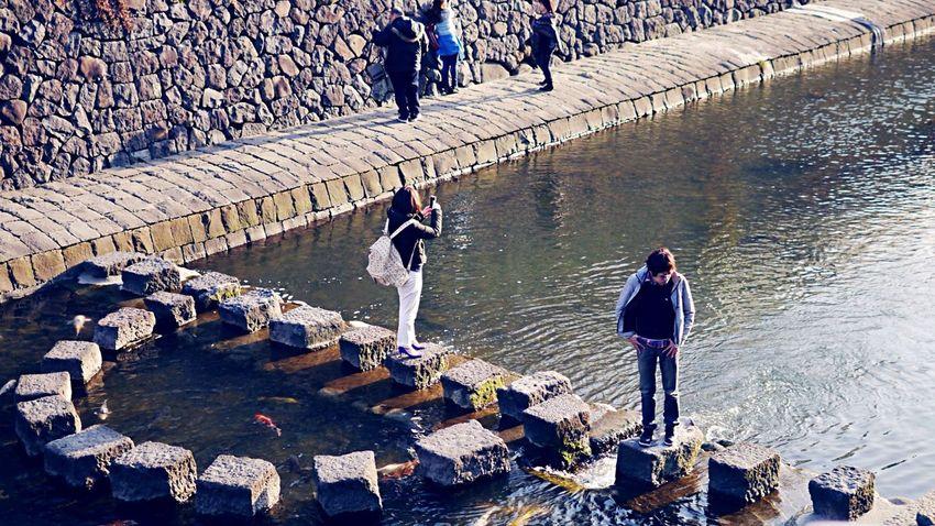 Riverside Nakashima River, Nagasaki City : 16:9 Crop People Watching Streetphoto_color Urban4 filter plus/ Panasonic  LUMIX GX1 50mm prime lens