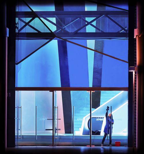 People standing on glass window