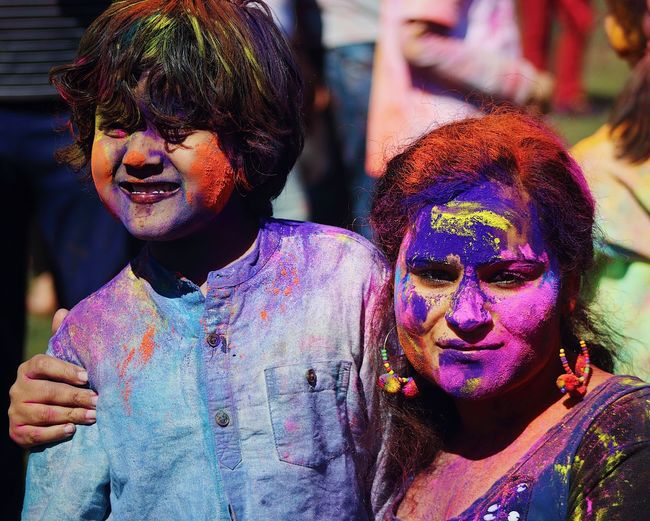Mother and son with powder paint on faces during holi