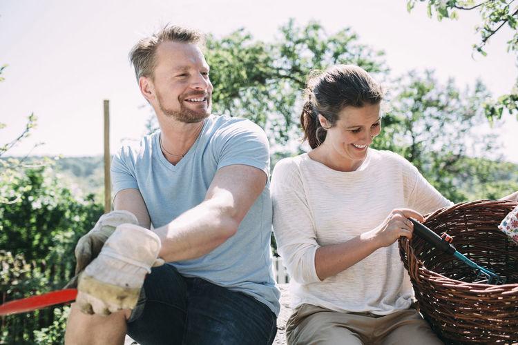 Happy friends sitting in basket