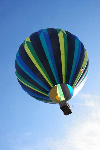 Low angle view of hot air balloon against blue sky