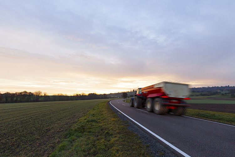 Driving Tractor On The Road Agriculture Day Delivery Drive Driving Farmer Farming Fast Germany Grass Highway Motion Blur No People Semi-truck Speed Sunset Tractor Transportation Truck Waldenburg Water Way