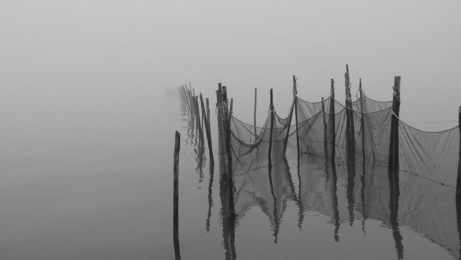 Don't fall in the net! Nature Water No People Outdoors Foggy Day Fishing By Net Lagoon Burano November