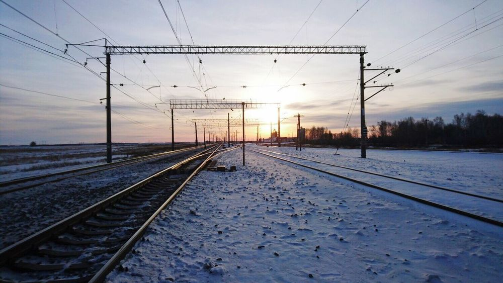 Winter Snow Cold Temperature Railroad Track Cable Sunset Power Line  Rail Transportation Weather Electricity  Electricity Pylon Transportation Sun Nature Power Supply Sky Sunlight No People Outdoors Beauty In Nature