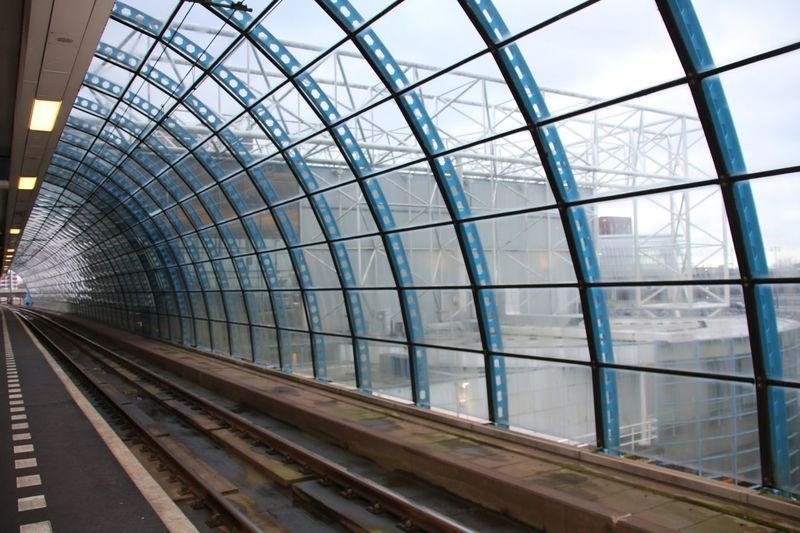 Glass - Material Architecture Indoors  Built Structure Railroad Track Modern City Railroad Station Business Finance And Industry Steel Station Day Skyscraper No People Futuristic Sky