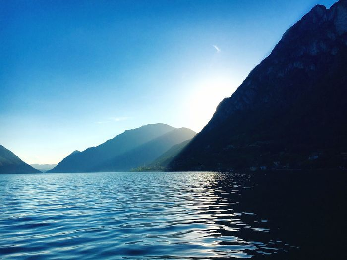 Mountain Water Beauty In Nature Mountain Range Scenics Blue Waterfront Idyllic Outdoors Day No People Nature Sky Tranquility Tranquil Scene