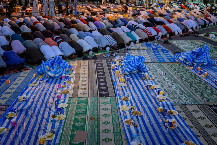 Islamic men bending while praying