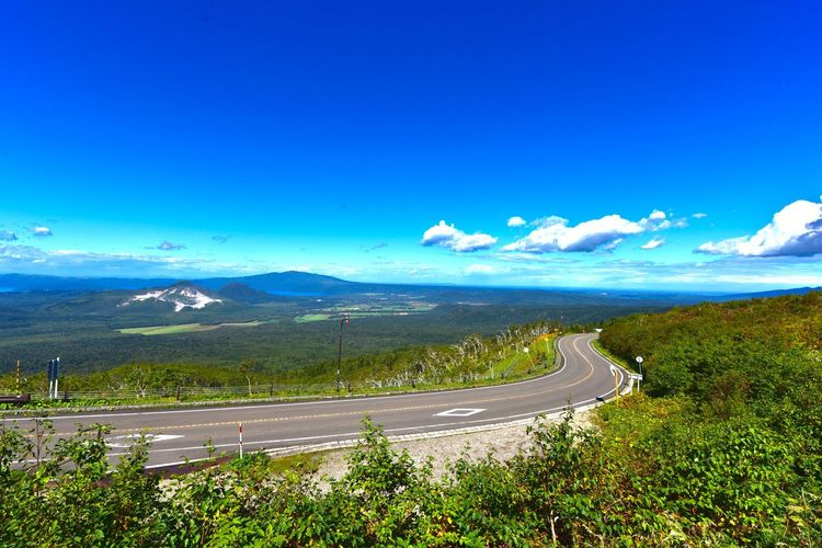 Sky Road Transportation Blue Scenics - Nature Beauty In Nature Mountain Idyllic No People Landscape Environment Tranquility Nature Day Tranquil Scene Non-urban Scene Plant Curve Copy Space Winding Road