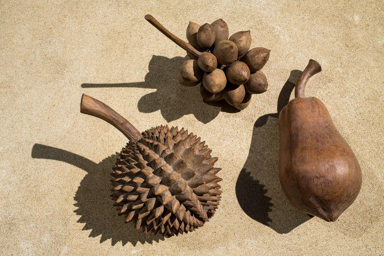 Wooden fruits, Durian, Palm, Papaya Art And Craft Copy Space Creative Light and Shadow Durian Backgrounds Brown Cement Close-up Conceptual Photography  Craft Design Food Fruit Fruit Photography Fruits Handmade High Angle View Idea Papaya Plam Textrue Thai Food Wood - Material Wooden