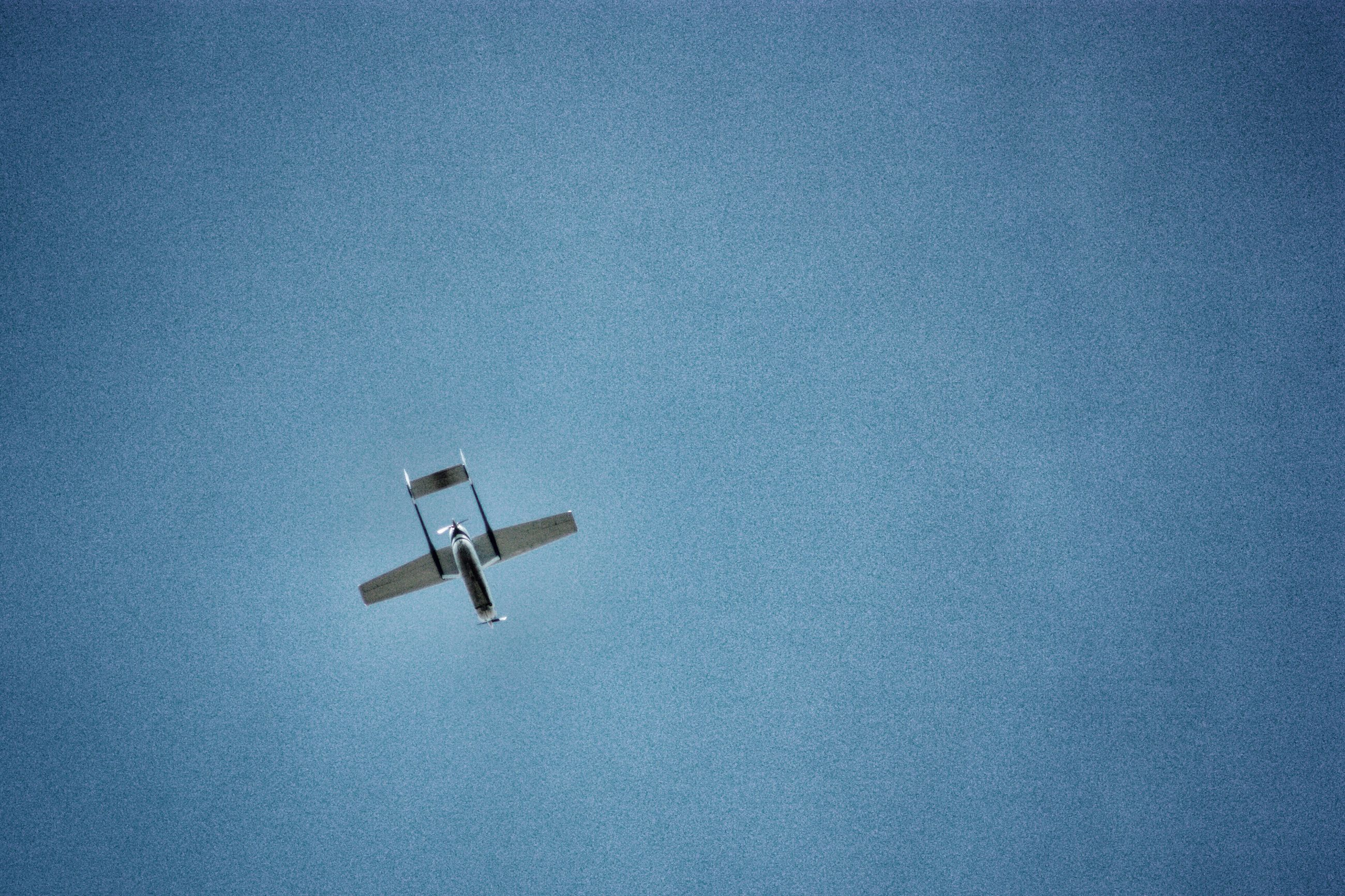 copy space, blue, security camera, no people, technology, clear sky, day, flying, sky, outdoors, close-up