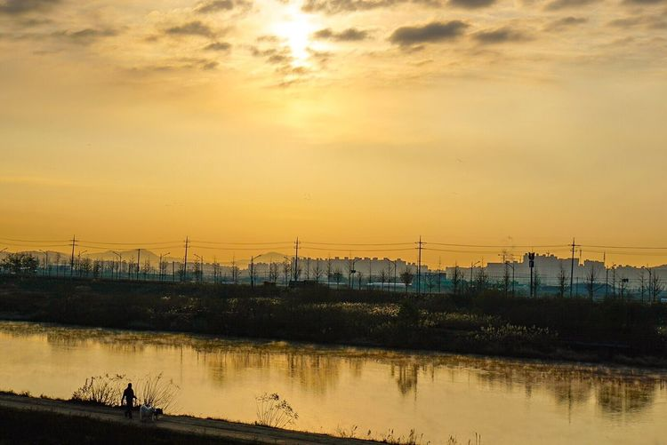 Sunset Reflection Water Sky Lake Nature Beauty In Nature Outdoors No People Silhouette Scenics Electricity Pylon Tree Day
