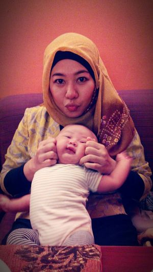 with my lovely son... and he always move if we want to take a picture... =)
