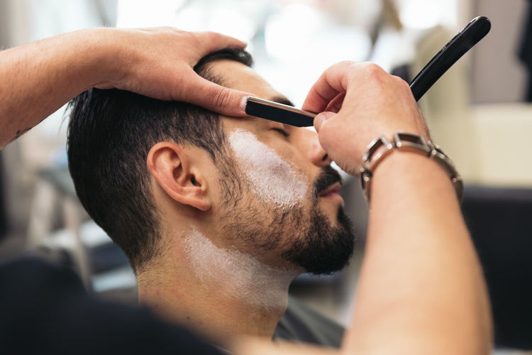Close-up of man at barber shop
