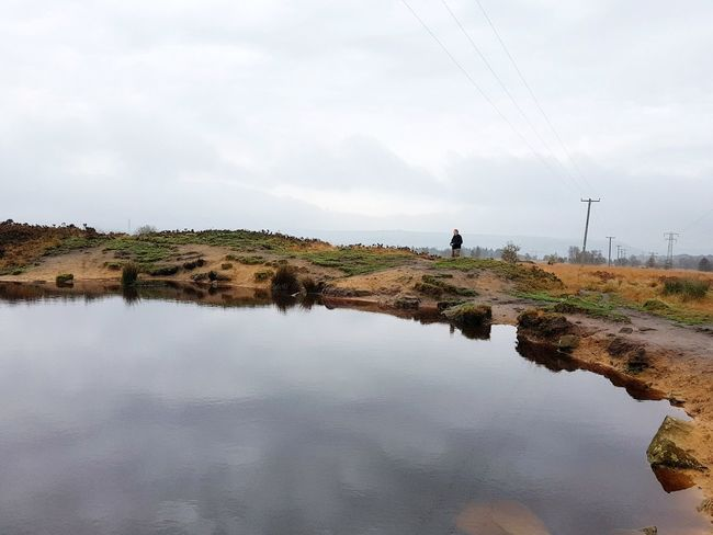 Water Reflection Lake Cloud - Sky Extreme Weather Day Sky Adult Outdoors Rural Scene People Nature One Person Adults Only Beauty In Nature Only Men Photography Themes One Man Only Irrigation Equipment Young Adult Norland Moor Yorkshire Landscapes Scenics Pylon Lost In The Landscape Connected By Travel Second Acts