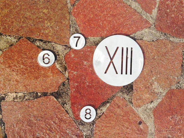 Directly above shot of numbers carved on footpath