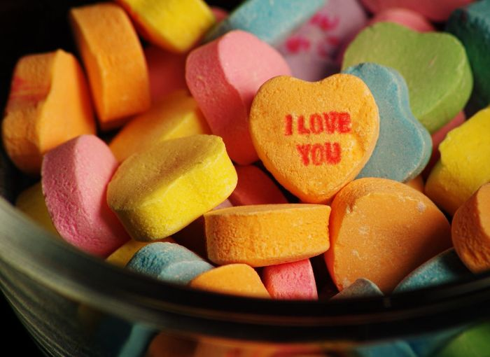Pastel colored hard Valentine's Day Candy with word I love you printed on it Spring Word Red Pink Color Friend Boy Girl Husband Wife Couple Shape Heart Love February Holiday Sweet Food Heart Shape Food And Drink Candy Food Close-up Text Love Large Group Of Objects No People Multi Colored