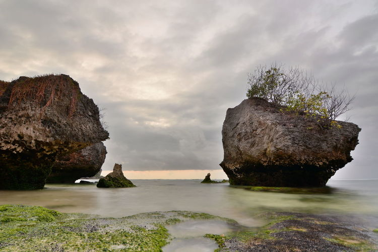 Padang Padang beach. Bali. Indonesia Padang Padang Beach - Bali Padang Padang Bali Bali, Indonesia INDONESIA Southeast Asia Southeastasia Rock - Object Sea Water Nature Scenics - Nature Beauty In Nature Tranquil Scene Outdoors Beach No People Cloud - Sky Tranquility Rock Formation Pecatu Rock