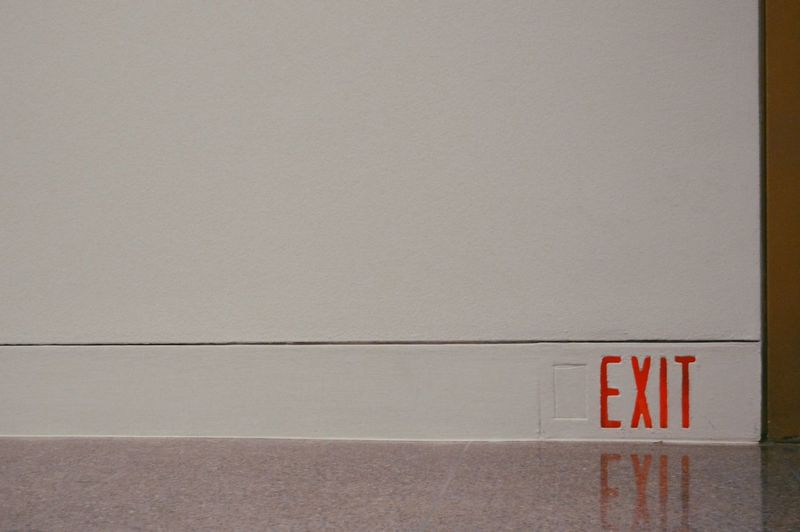 Exit sign on wall of museum