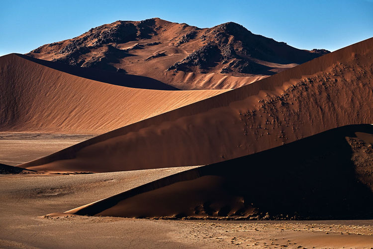 Sand dune blades fading into namib desert in africa