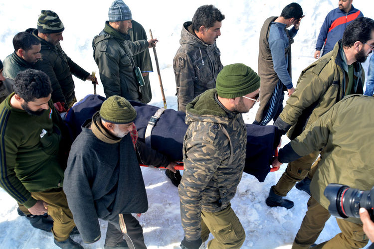 Policemen and rescue workers carry body of one of the victims, who died in avalanche at Jawahar Tunel, some 90 kilometers south of Srinagar, the summer capital of Indian Kashmir, 08 February 2019. Seven persons died and three others were rescued alive from the site of an avalanche. Ten people were in snow after an avalanche hit a police post near Jawahar Tunnel on 07 February evening Kashmir , India Winter Srinagar Kashmir Police Resur Operation Friday Warm Clothing Riot Men Shield Police Force