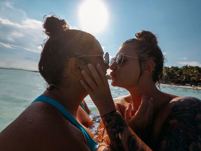 Beach Life Couple Happiness Happy Holiday Mexico Beach Beautiful Woman Couple - Relationship Enjoying Life Gay Kissing Leisure Activity Lgbt Lifestyles Ocean Ocean Life Positive Emotion Real People Sunglasses Togetherness Tropical Two People Vacation Water