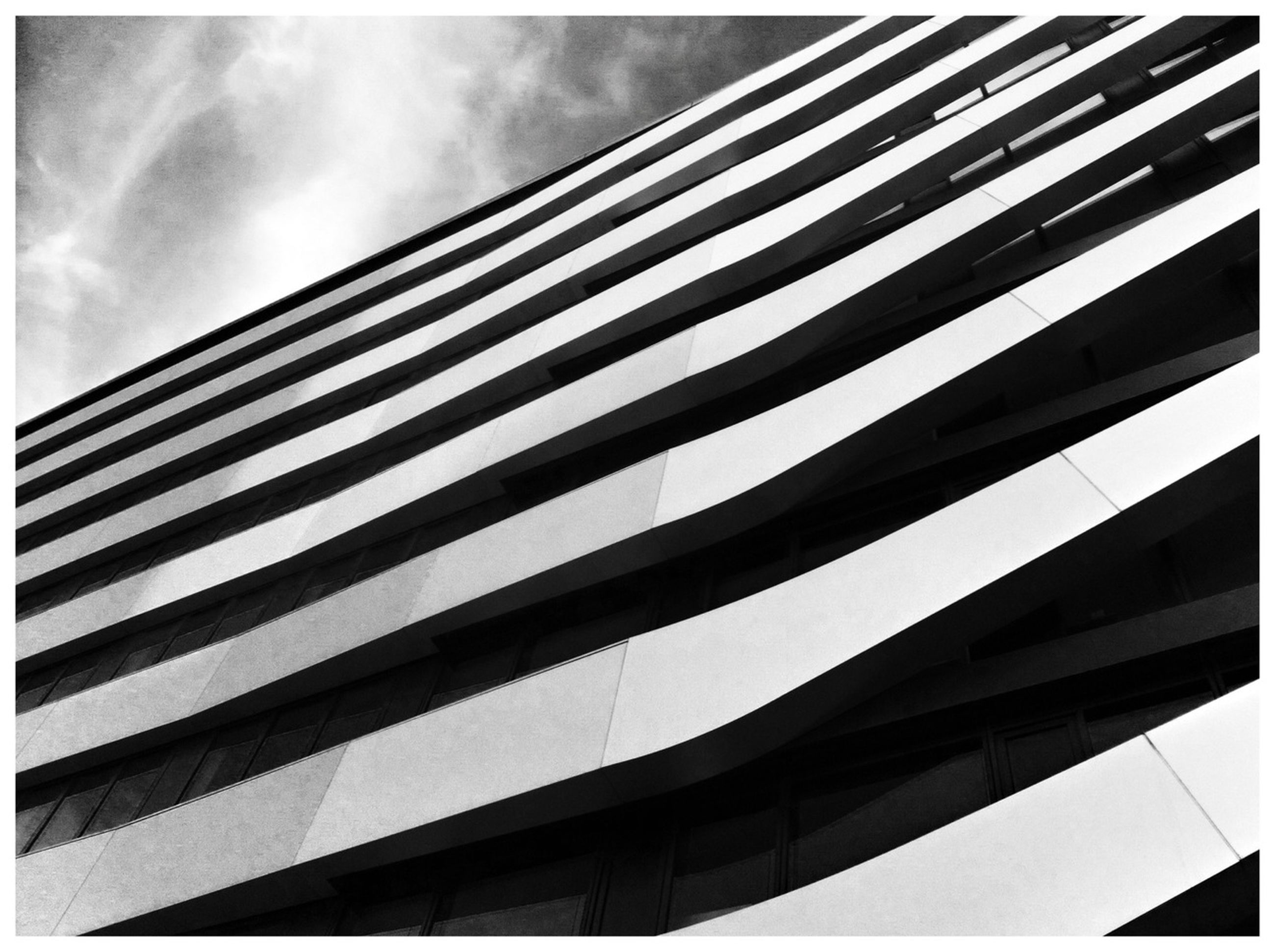 architecture, built structure, low angle view, building exterior, transfer print, modern, office building, auto post production filter, sky, city, skyscraper, building, glass - material, tall - high, reflection, pattern, day, tower, no people, outdoors